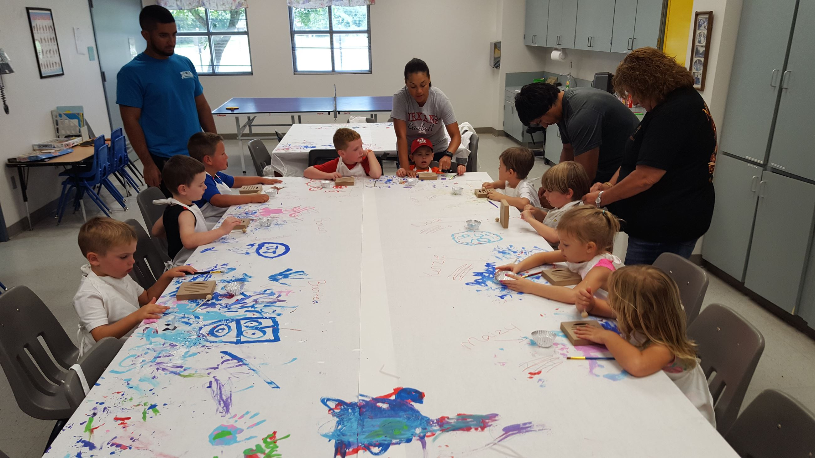Kids painting a table