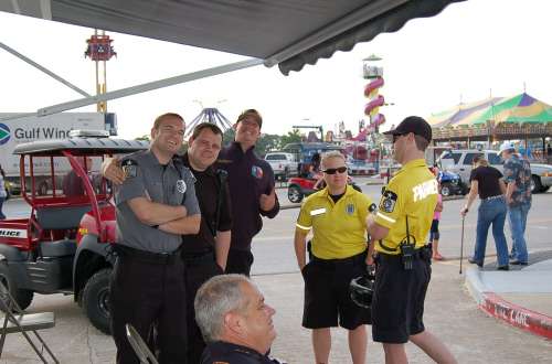 Bike medics talking with uniformed EMTs at the Sylvan Beach Festival in 2014