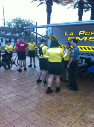 Uniformed EMTs in front of the EMS tent at an outside event