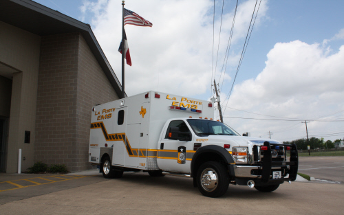 White ambulance outside of the EMS Headquarters