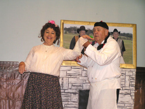 A man and a woman participating in a performing arts activity